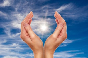hands over blue sky